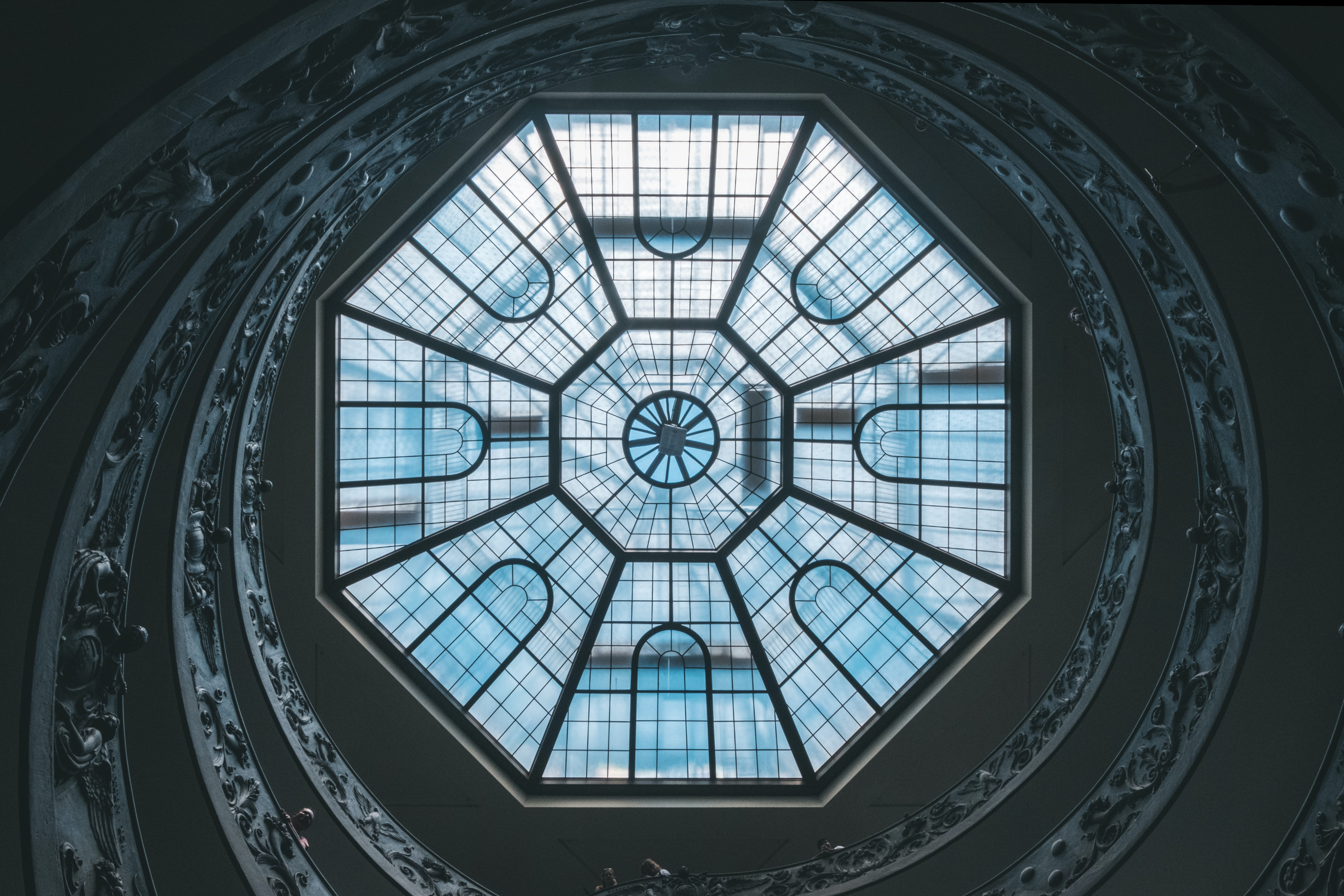 low angle photography of glass ceiling