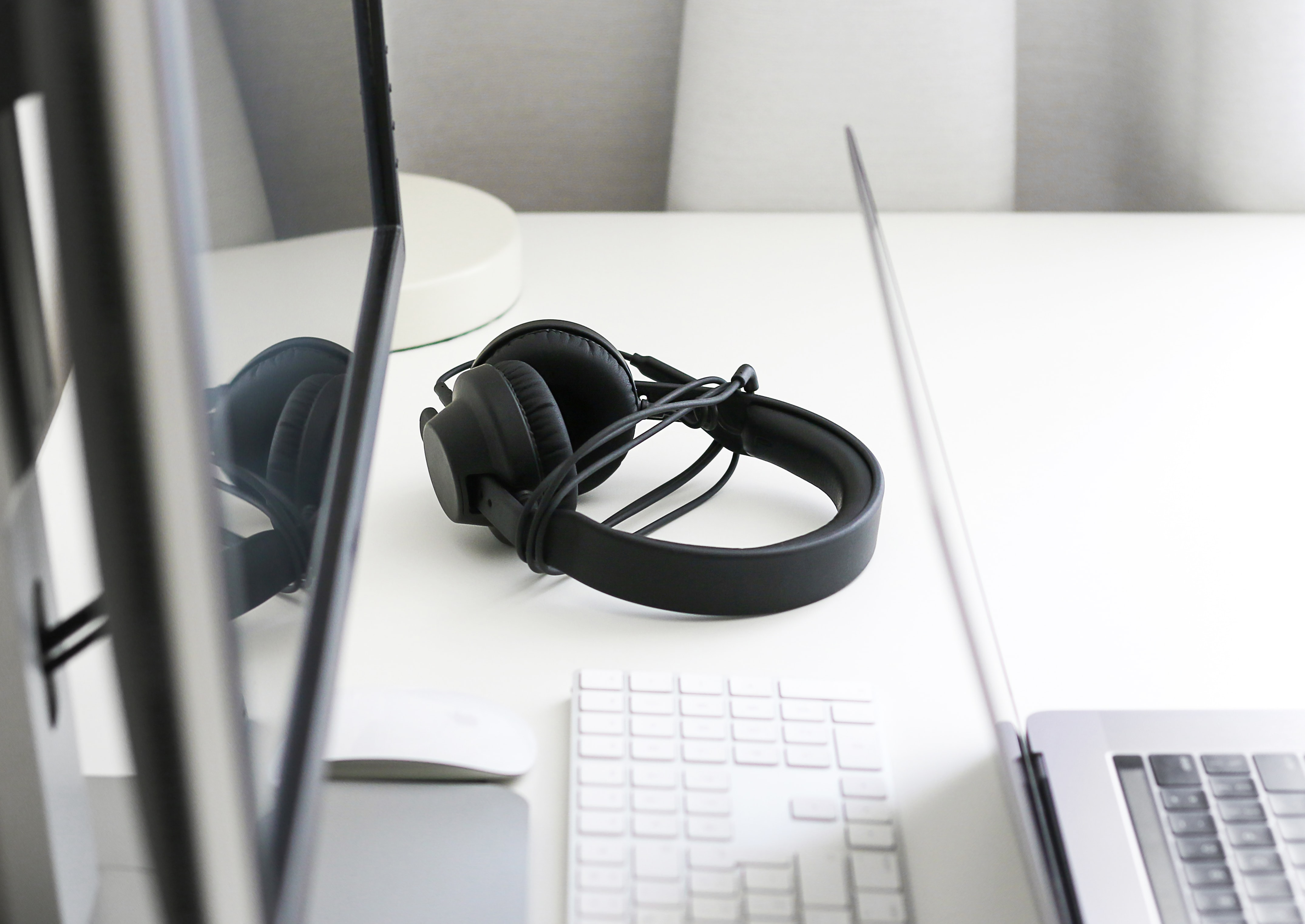 black corded headphones on white wooden table