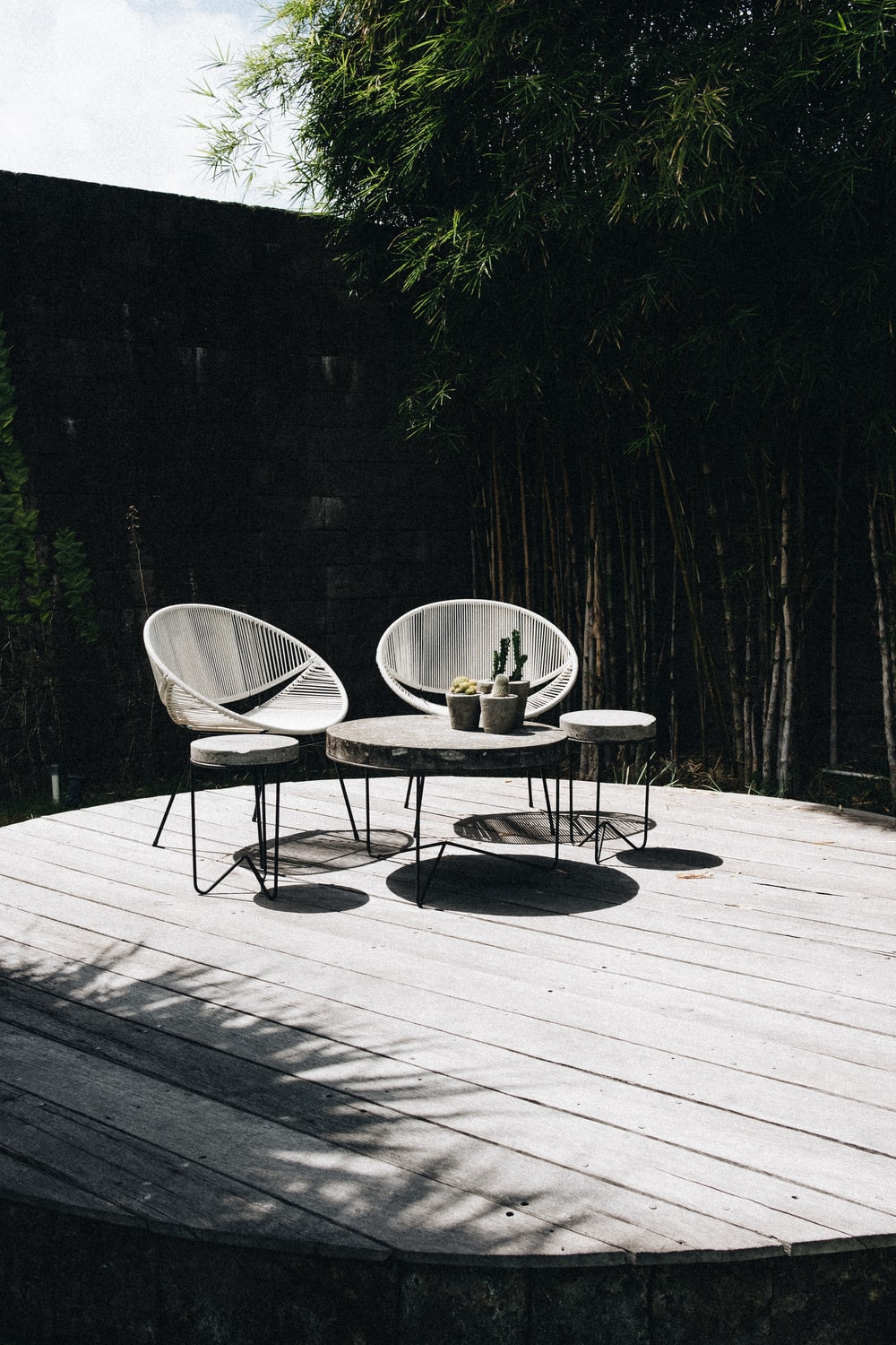 gray table with chair near trees