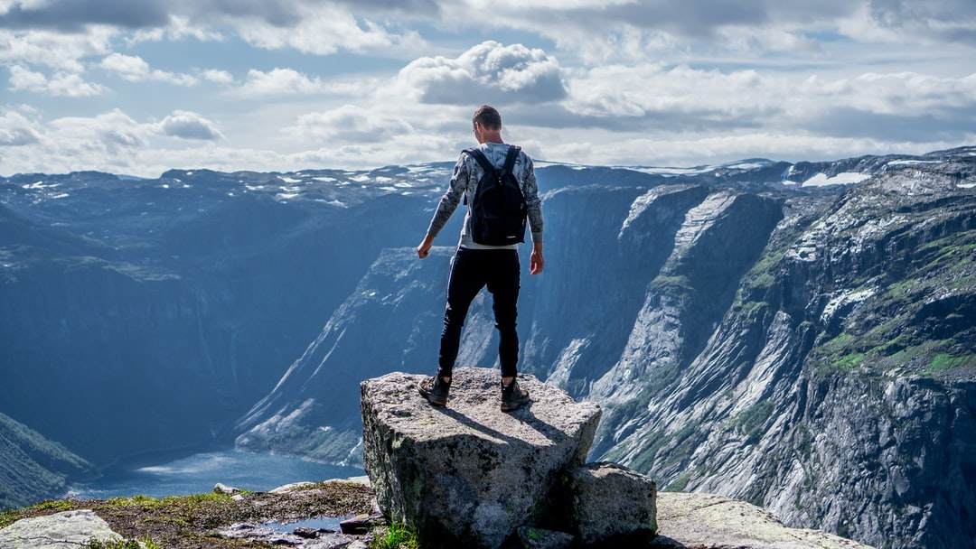 This is a photo of me standing and overlooking a fjord in Norway. We saw this on our way to the famous Trolltunga (Troll's Tongue).