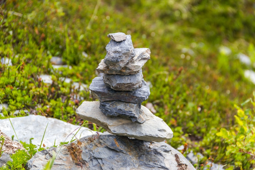 stacked stones beside grass