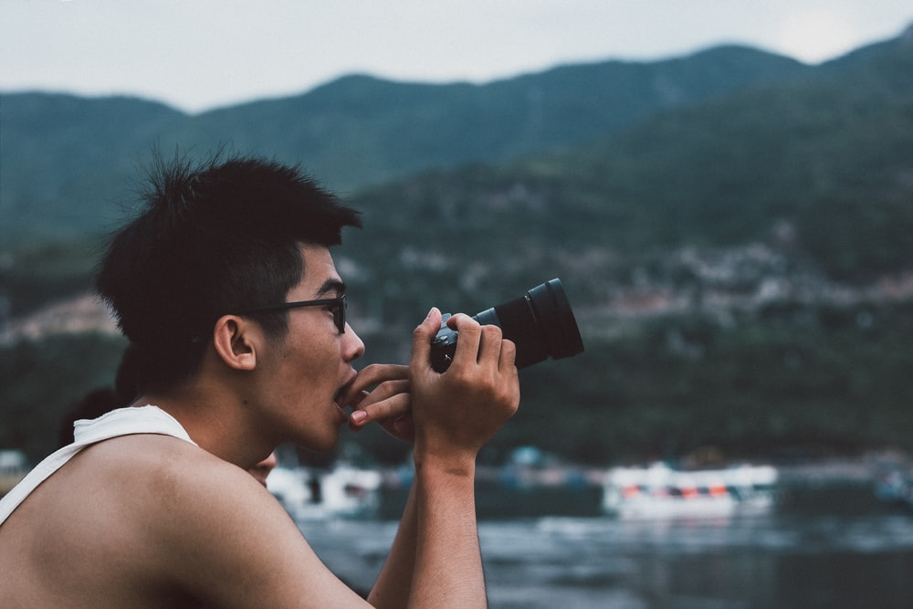 person holding camera while taking photo