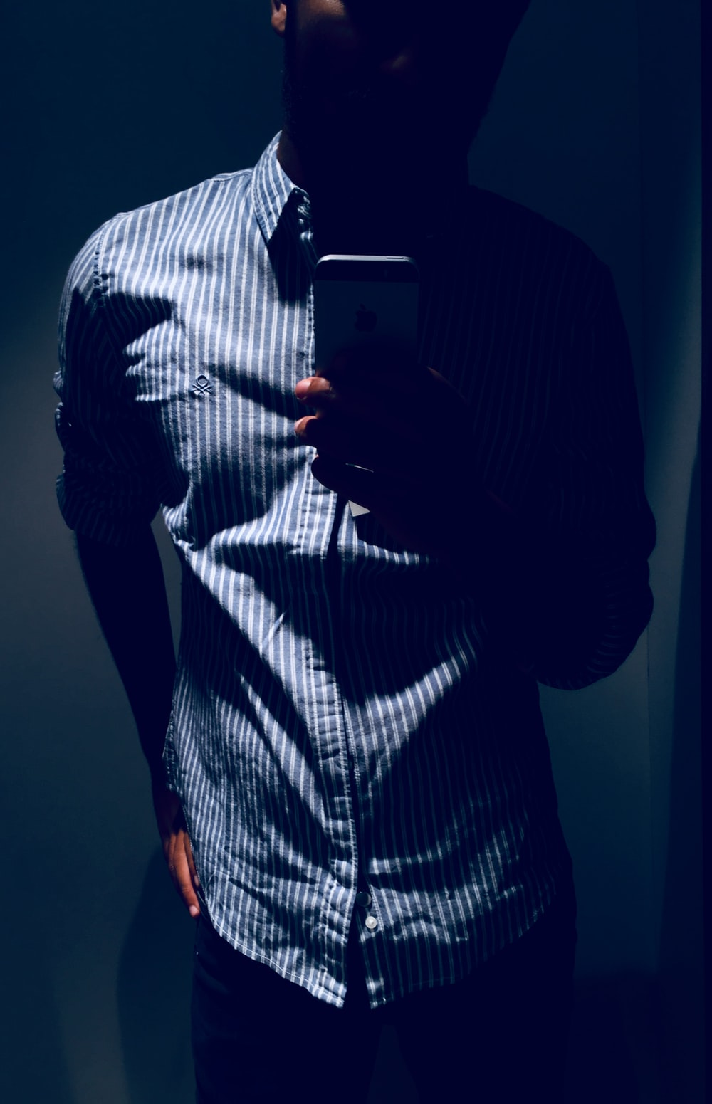 man wearing white and gray striped dress shirt