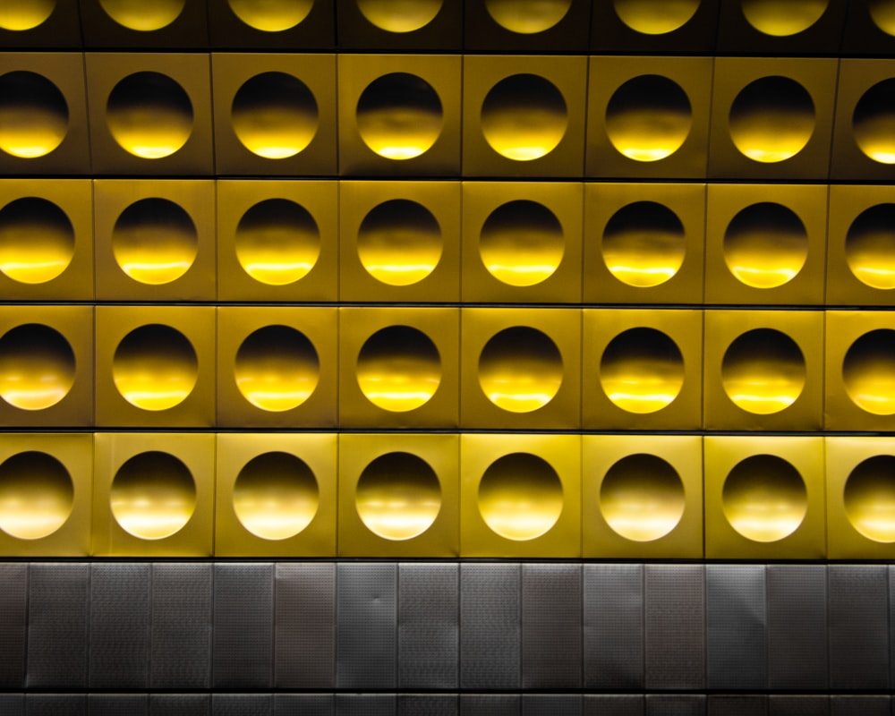 minimalist photography of gold and gray polka-dot wall