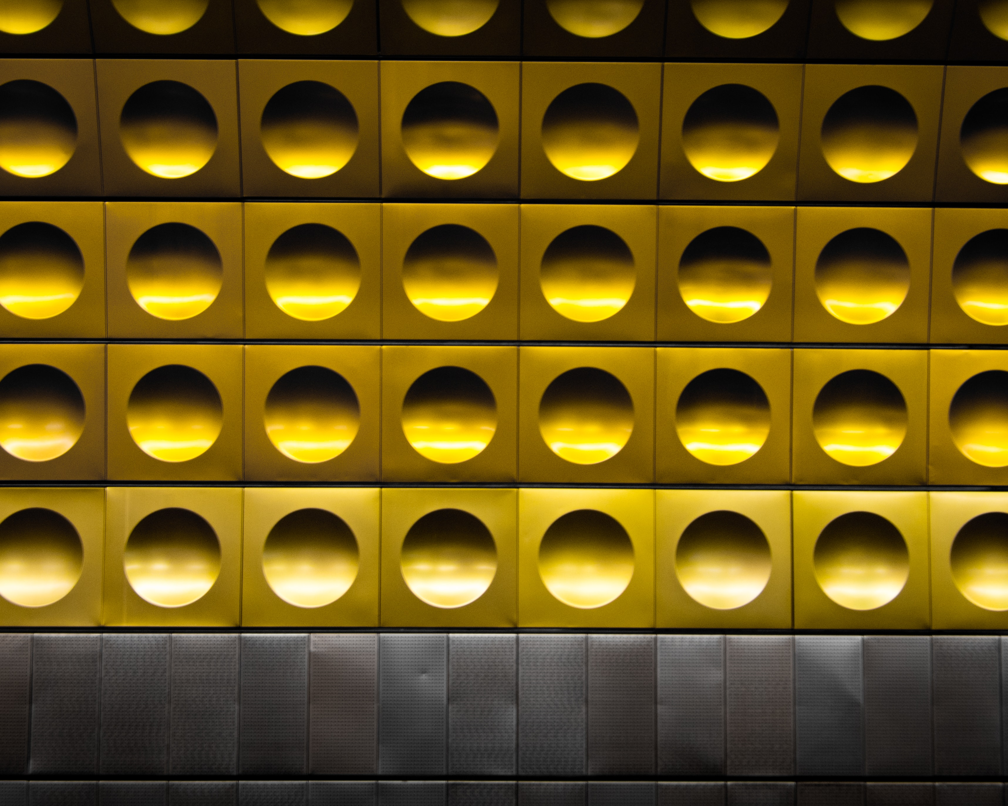 minimalist photography of gold and gray polka-dot wall