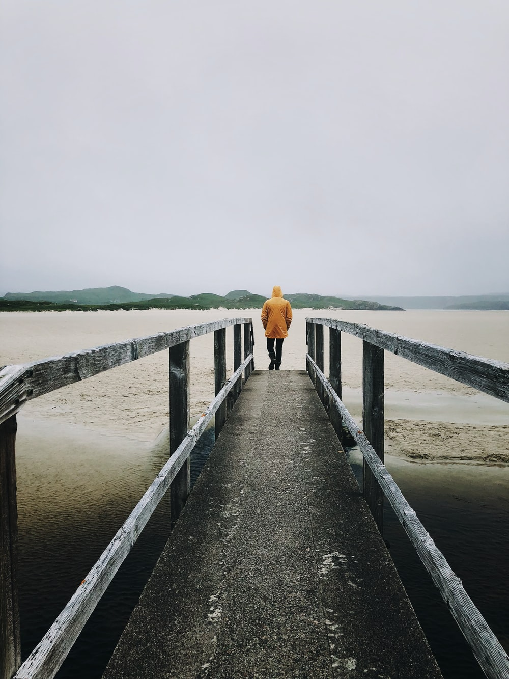man stand on dock near body of water