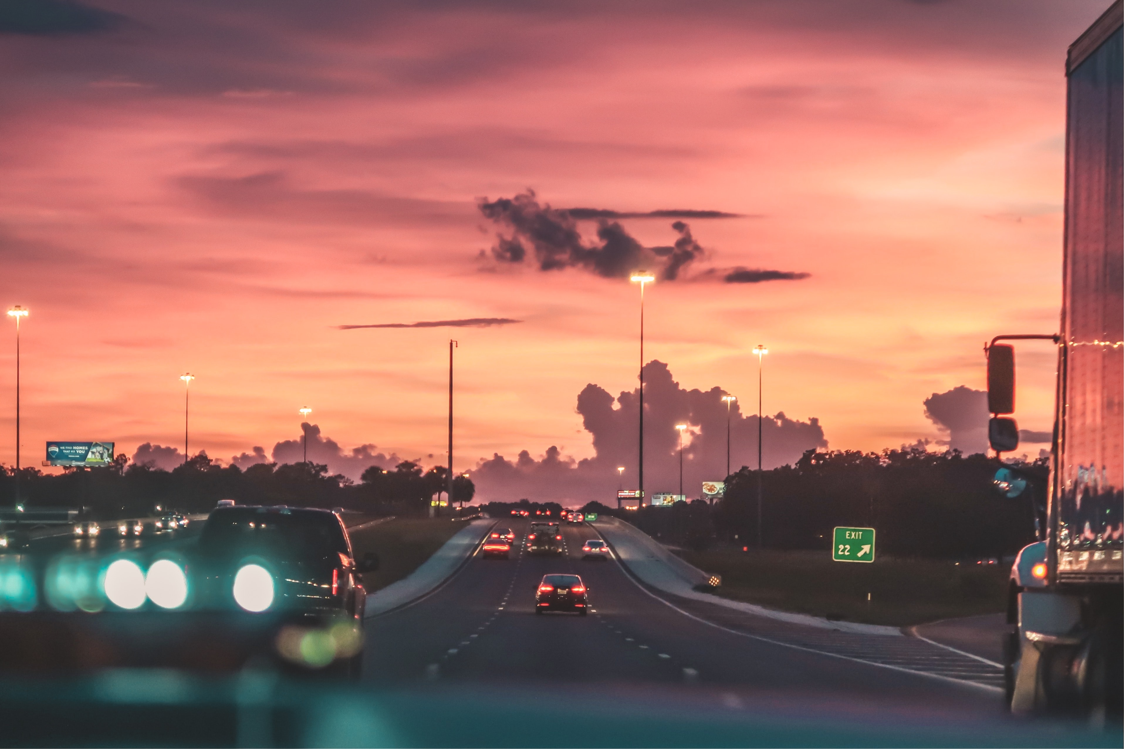 cars on road in sunset