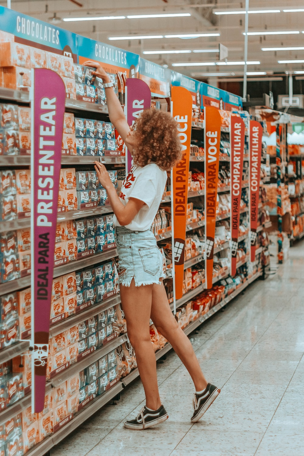 woman getting box of chocolate inside grocery