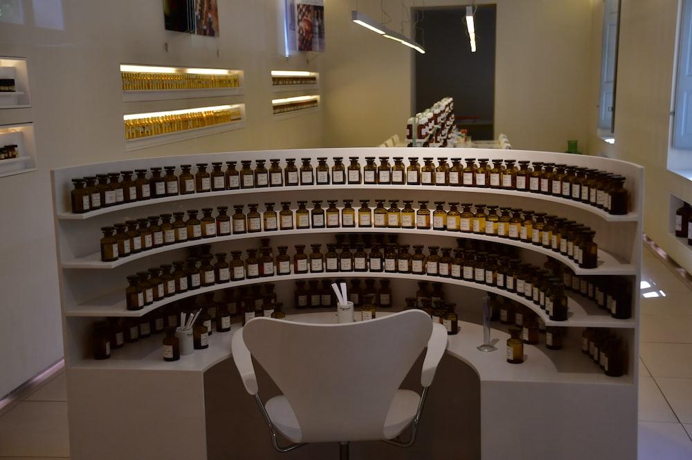 amber glass bottle lot inlined on white shelg