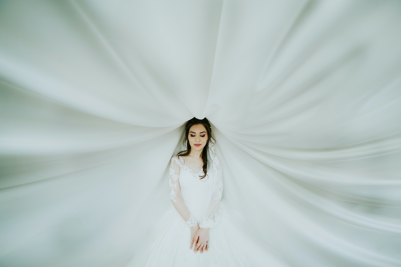woman wearing white long-sleeved dress