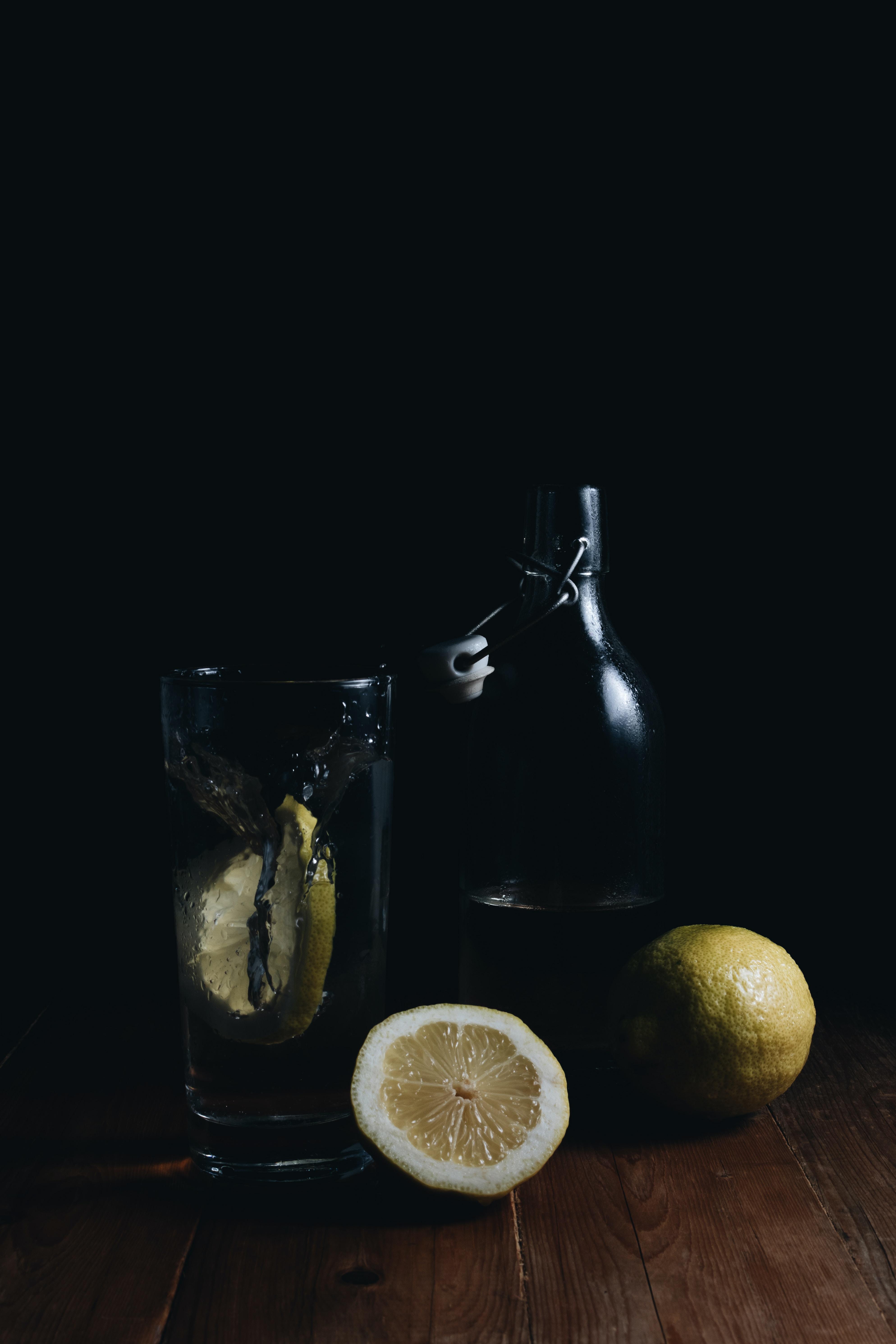 sliced lemons on wooden surface
