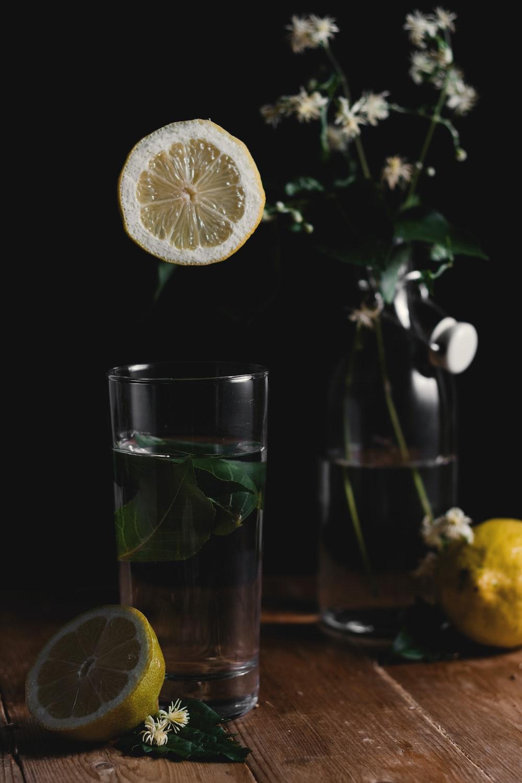 sliced lemon beside drinking glass