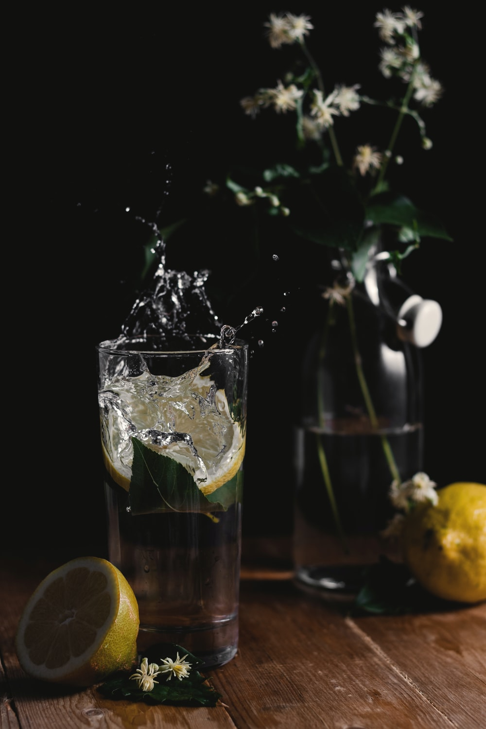 clear drinking glass filled with water and sliced lime