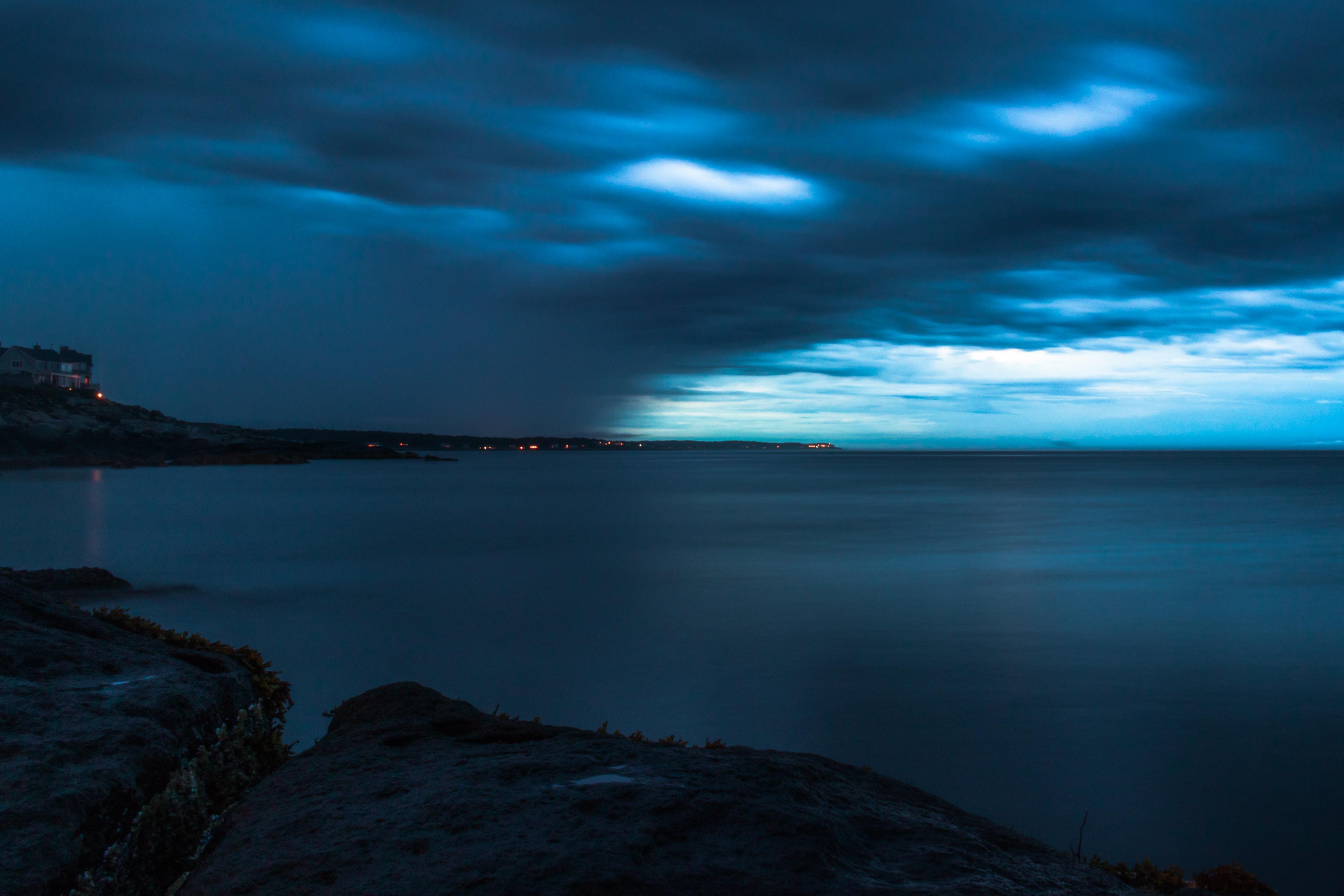 calm waters under cloudy skies
