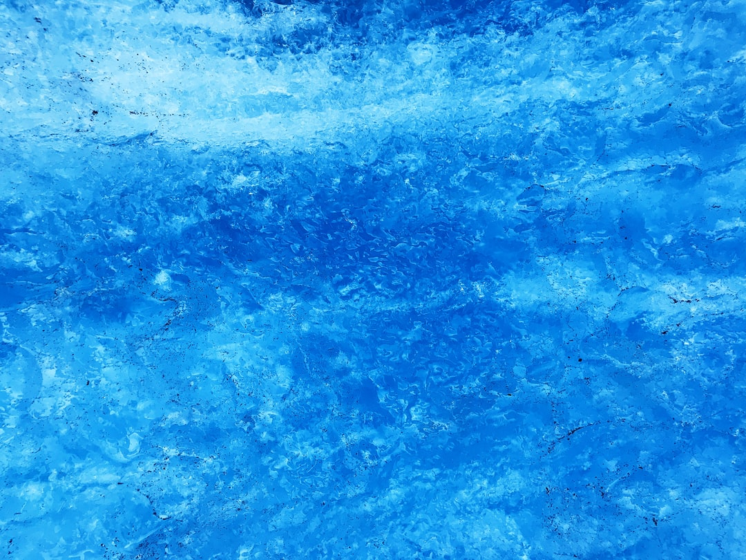 """My new favorite color is """"Glacier Blue,"""" the color of compressed glacier ice. I got to see this color for the first time during a hike across the top of Mendenhall Glacier in Alaska."""
