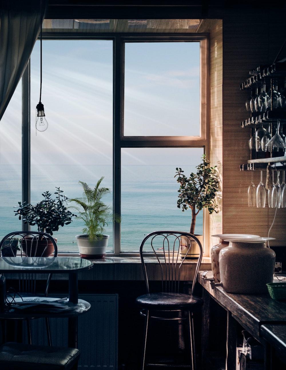 black bar stool near glass window