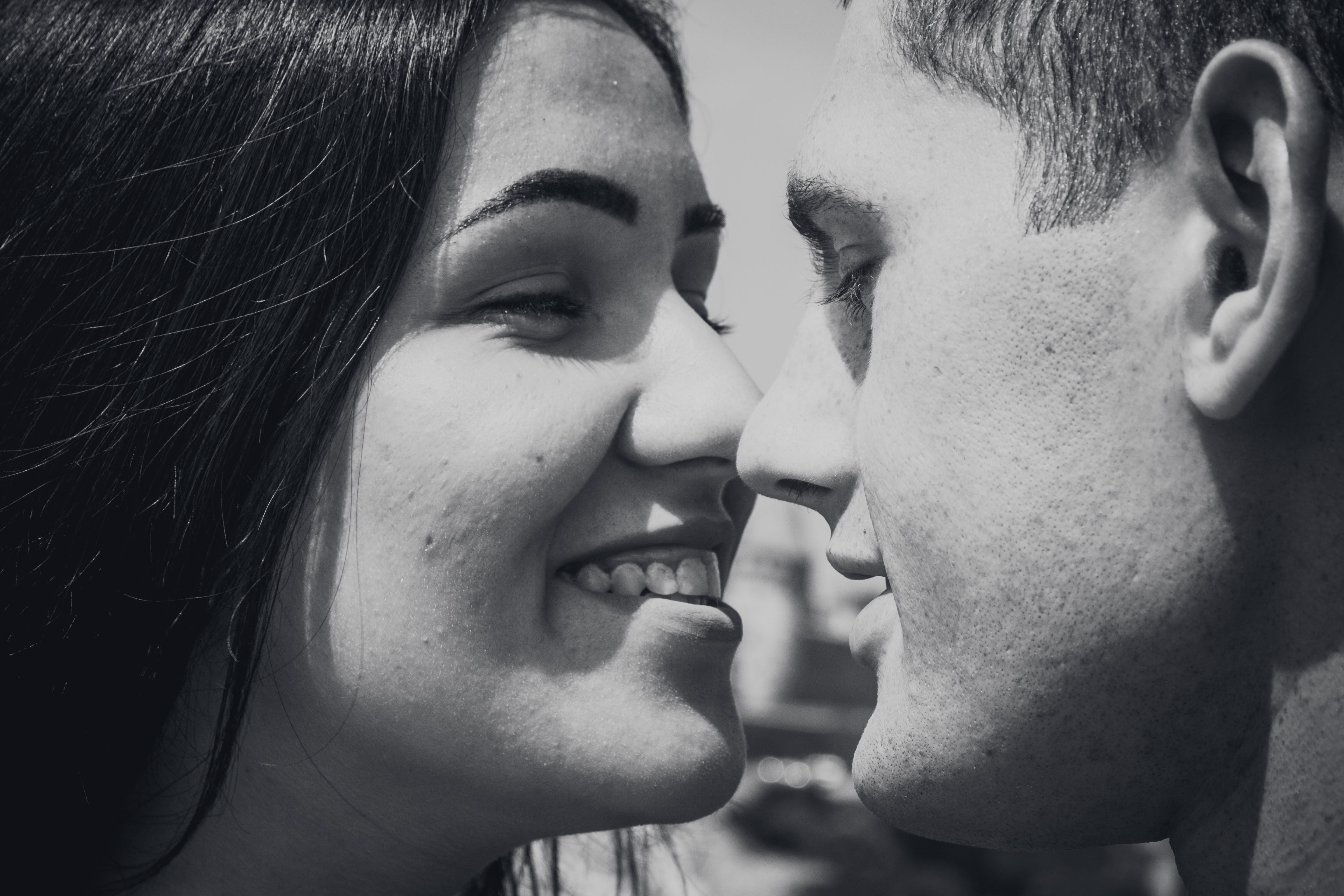 woman and man facing each other while smiling