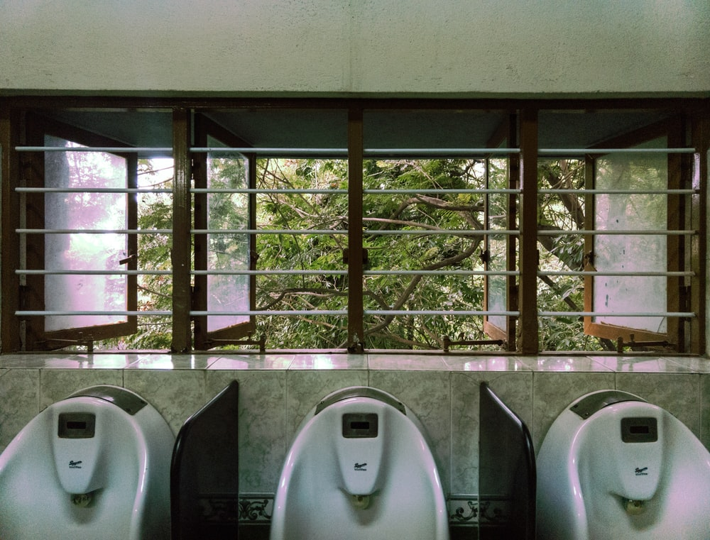 three male urinal in room