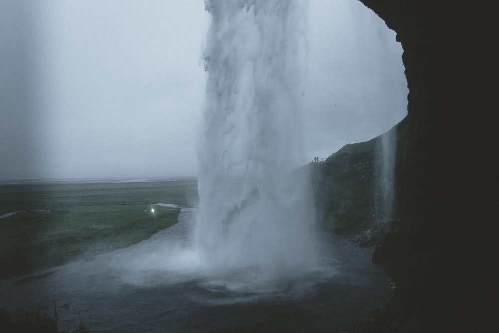 waterfall cave during day time