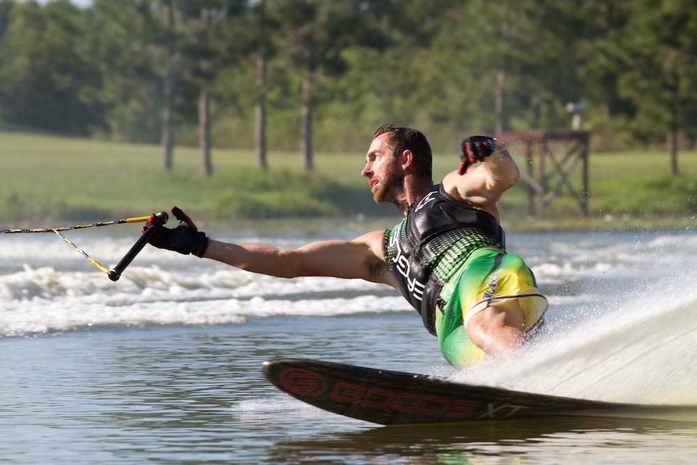 man riding wakeboard doing tricks