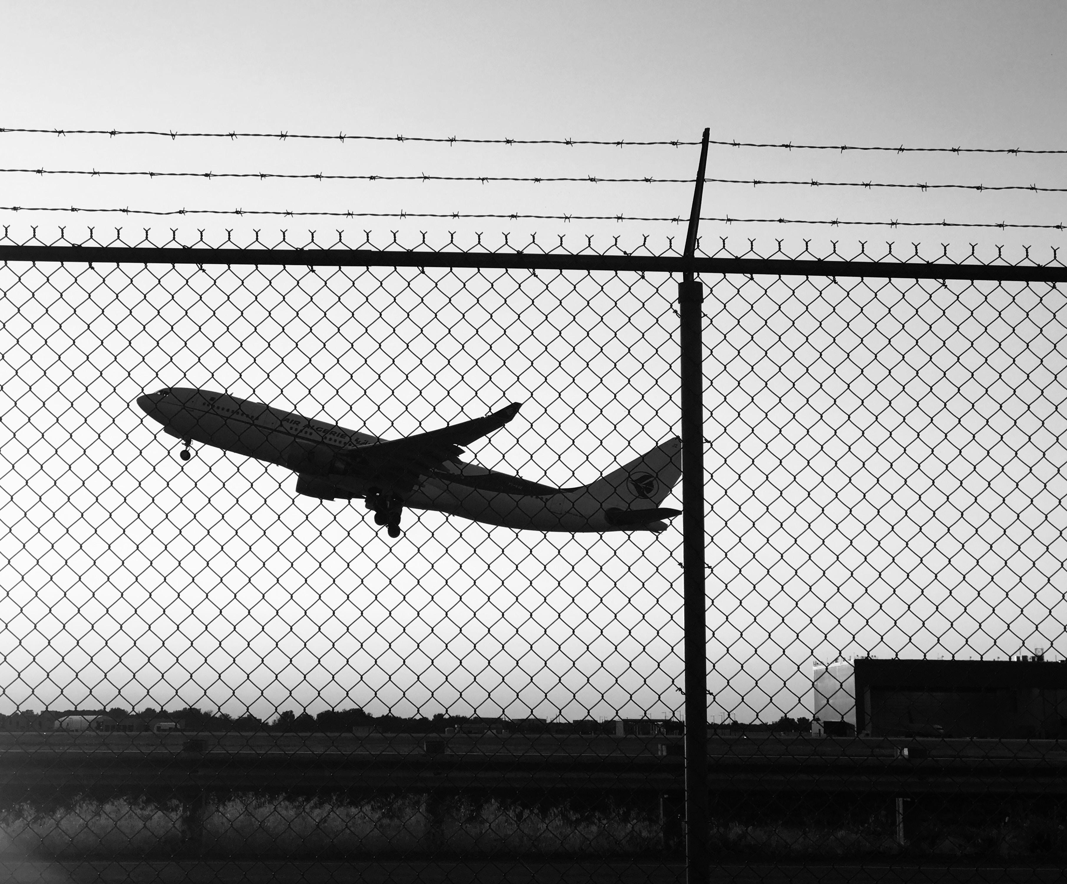 airplane taking off during daytime