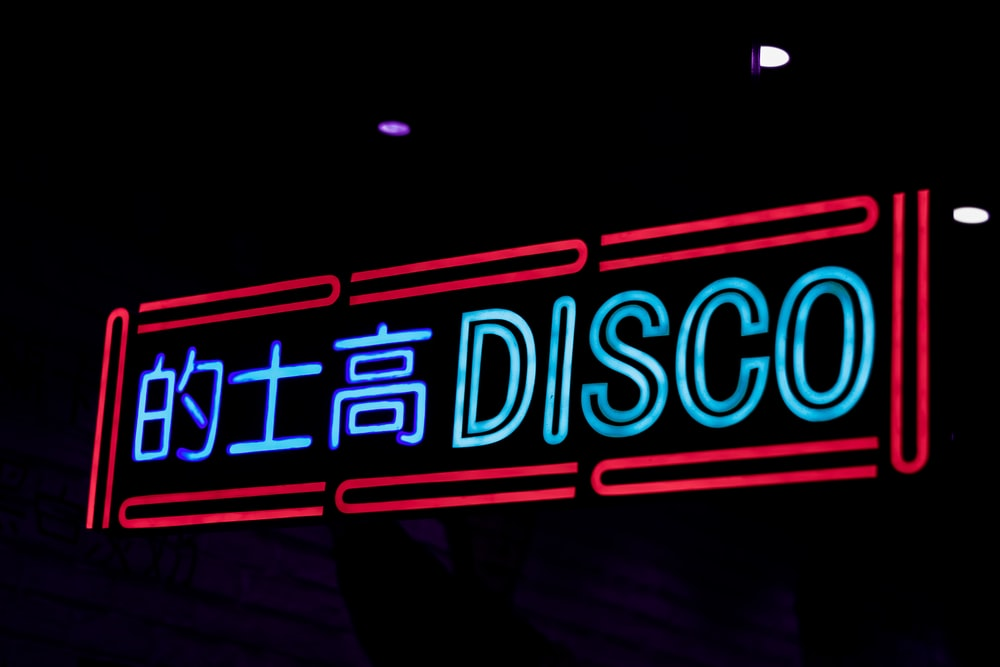 disco neon signage at nighttime