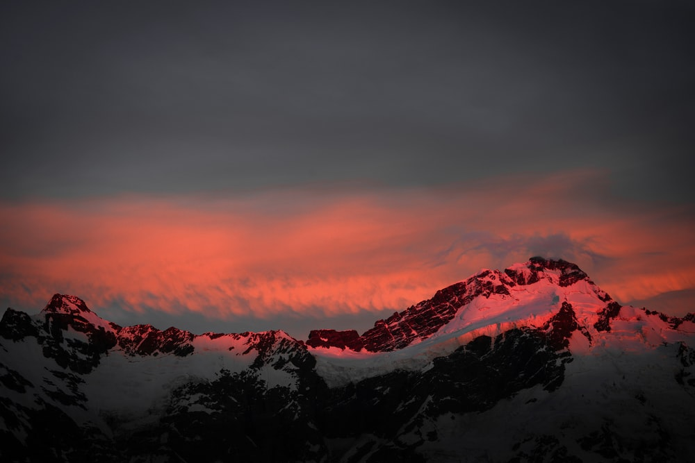 snow covered mountain at golden hour