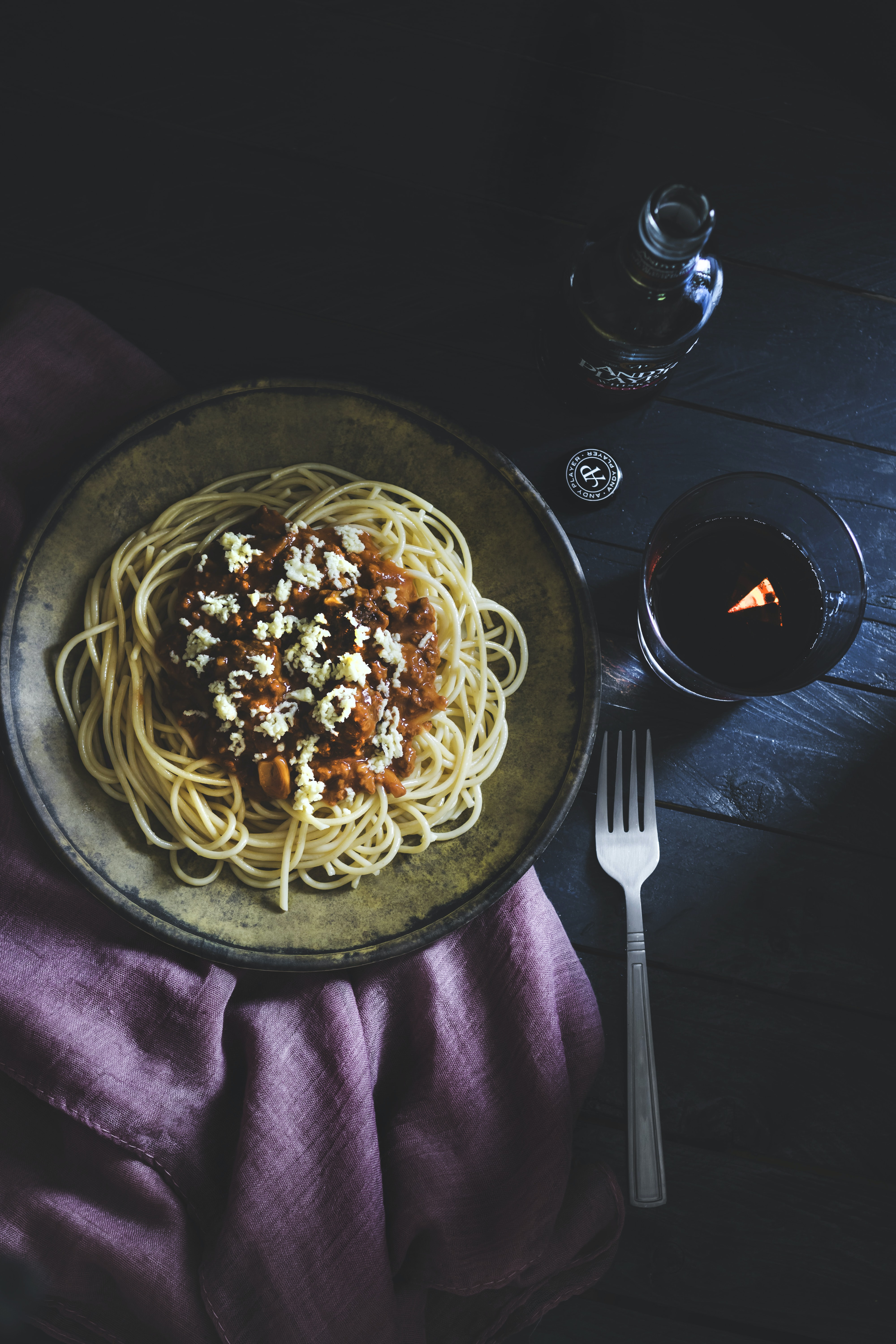 cooked pasta dish on round brown ceramic plate