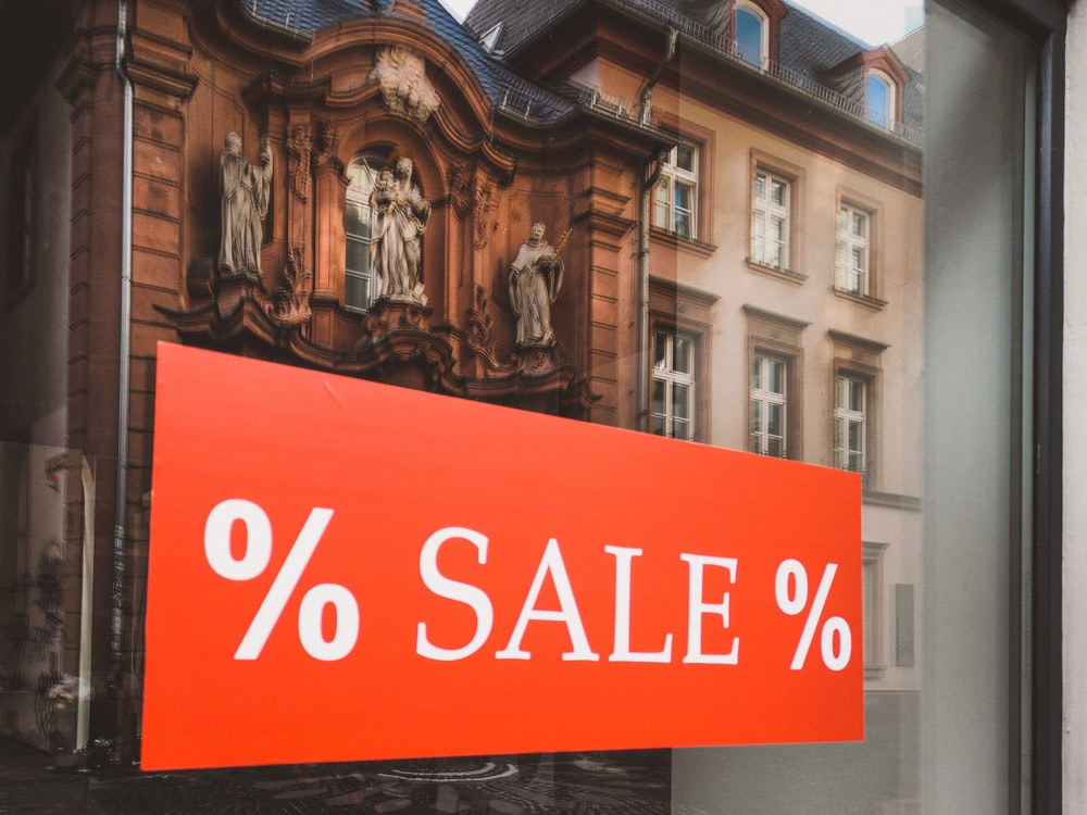 % sale % sign outside clear glass establishment