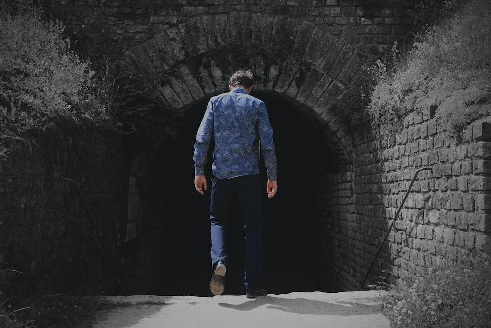 man walking to tunnel