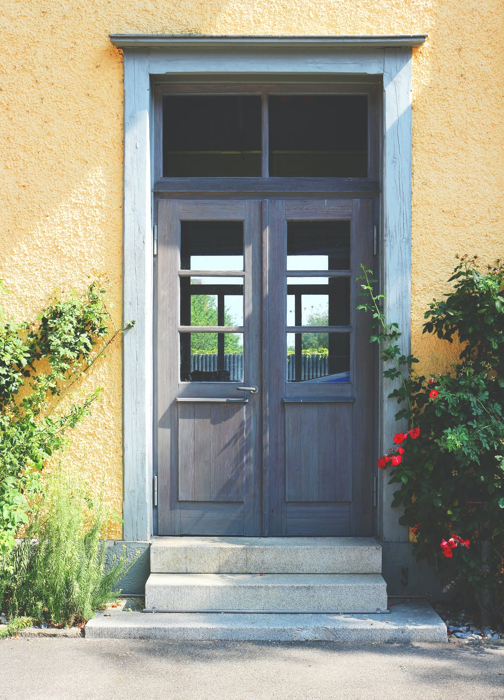 closed gray wooden doors during daytime