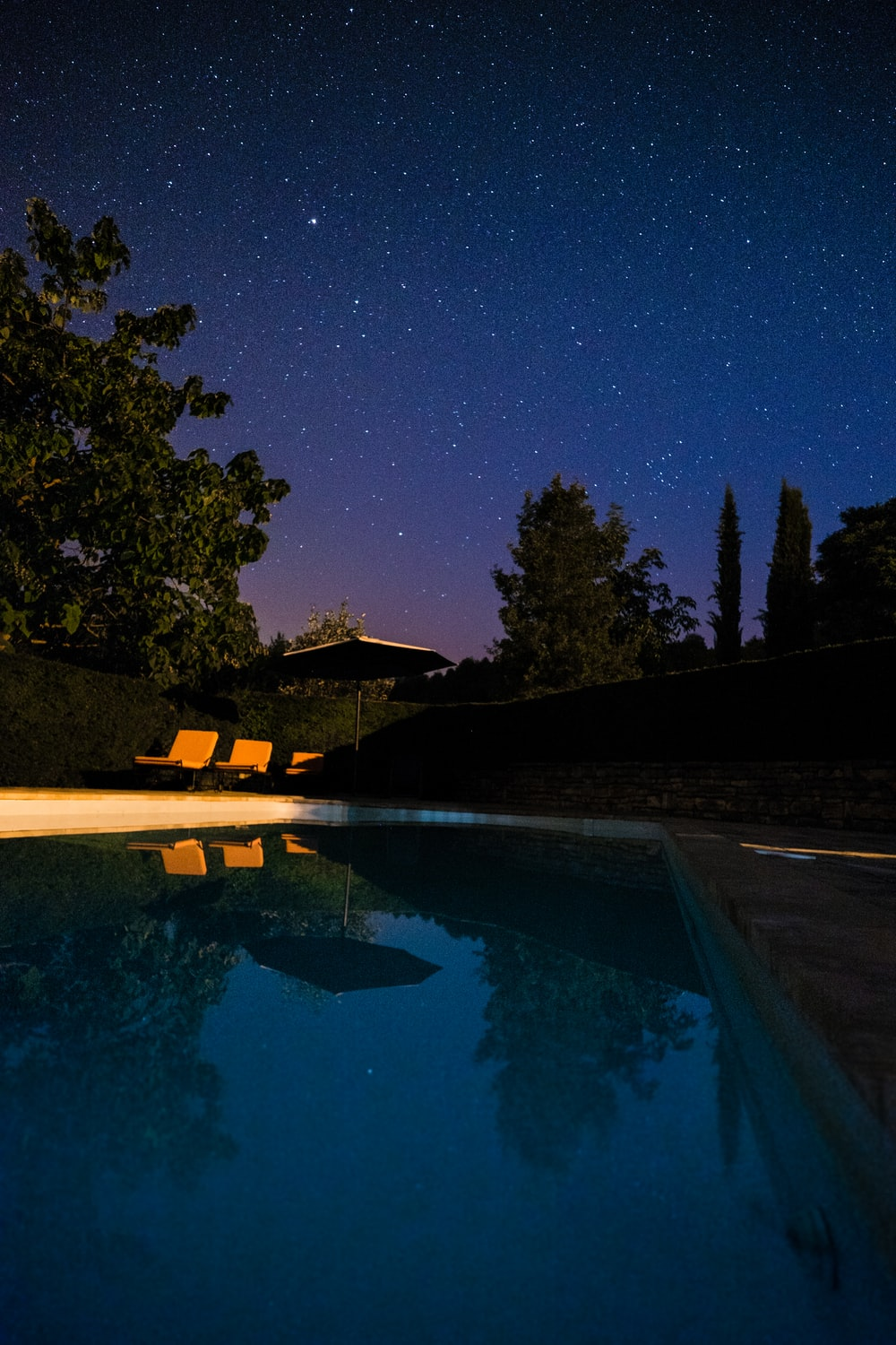 white and brown backyard pool during night time