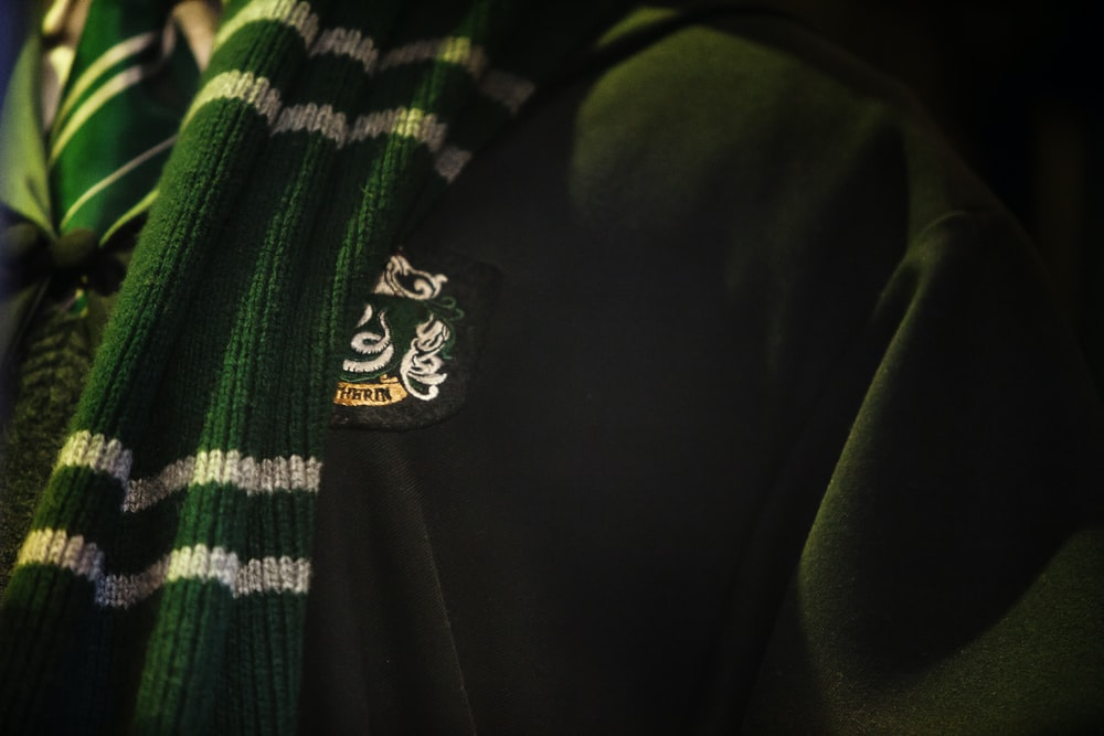 close photo of green and white scarf