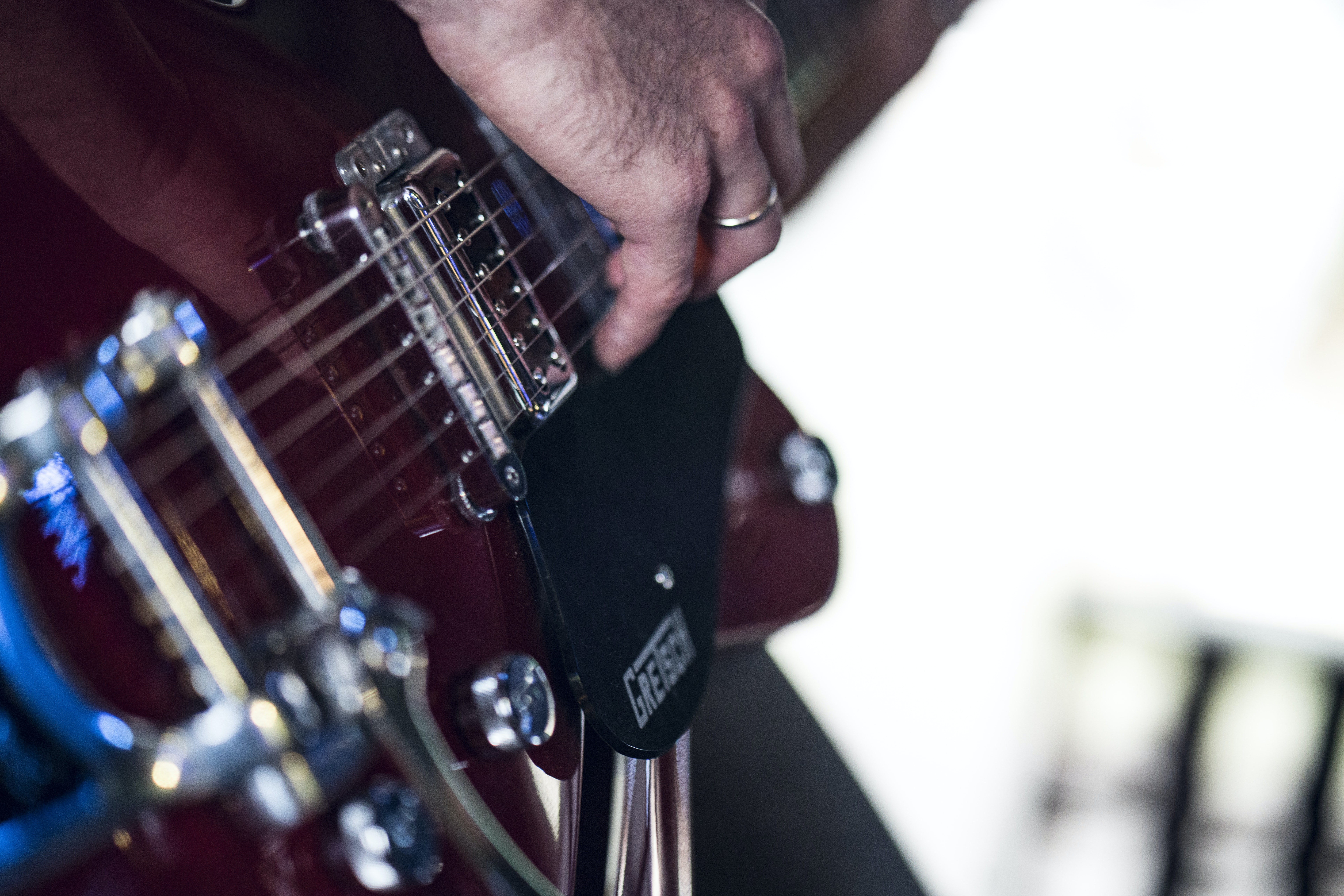 person using electric guitar
