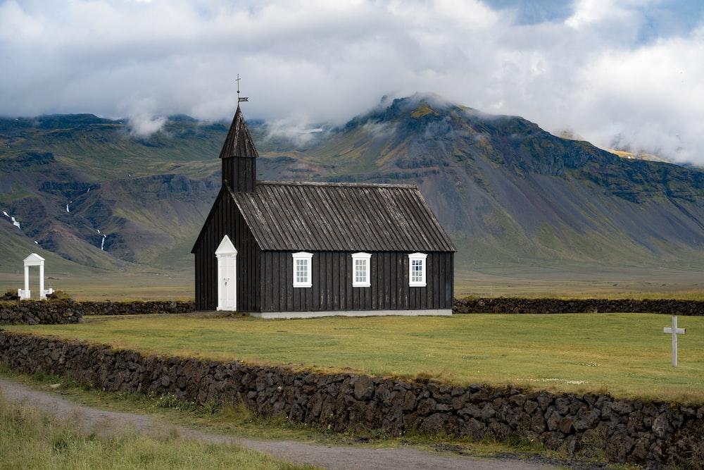 gray wooden church near mountain