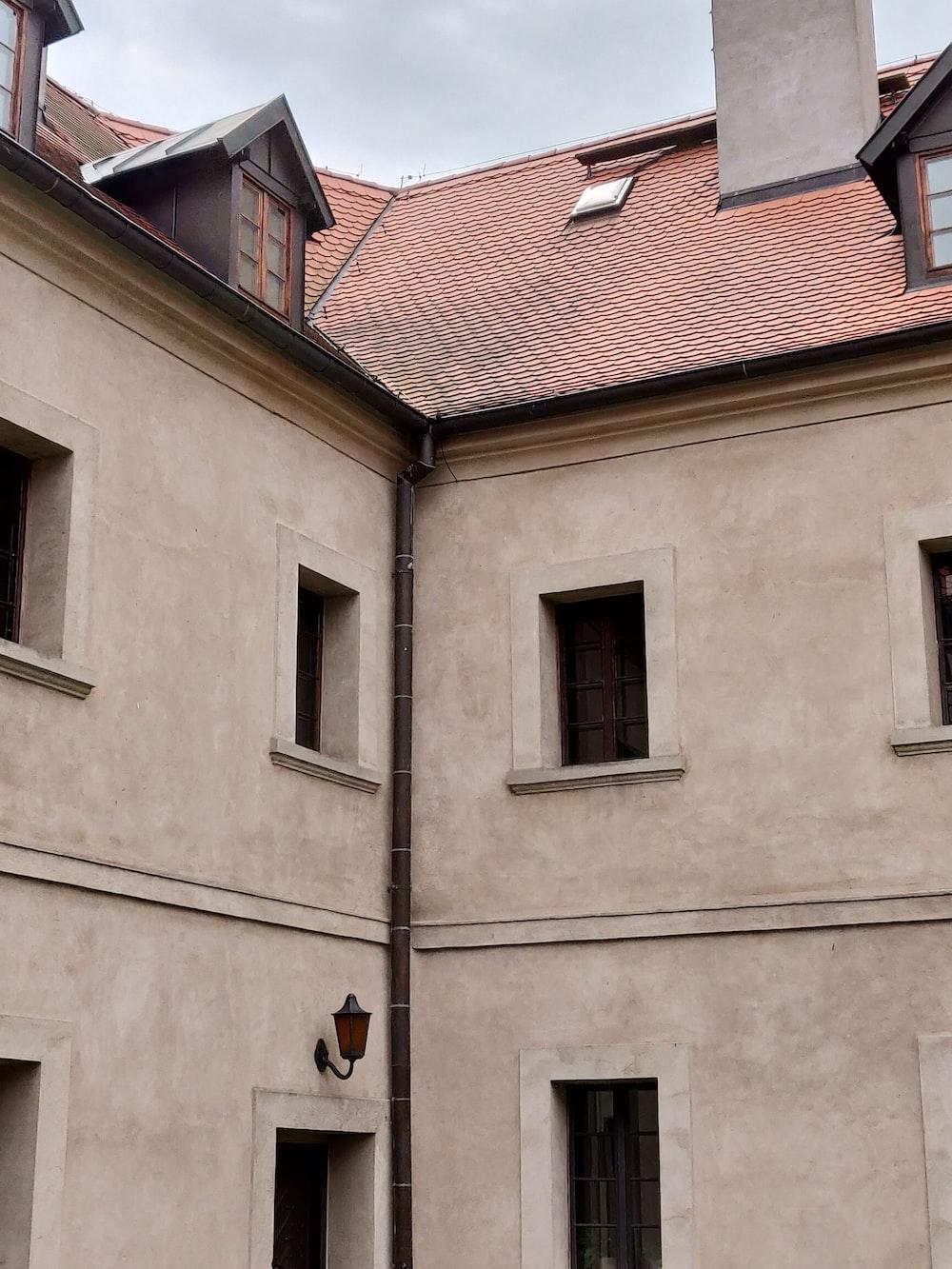 beige concrete 2-storey building during daytime