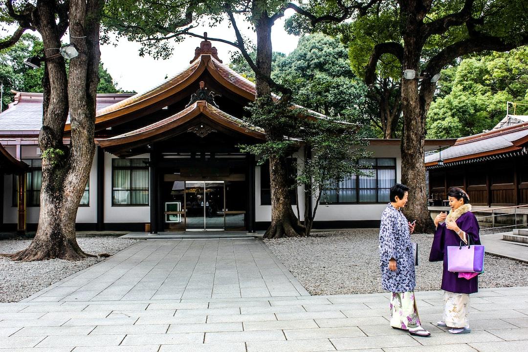 Women in Japanese dress talking at Meiji shrine