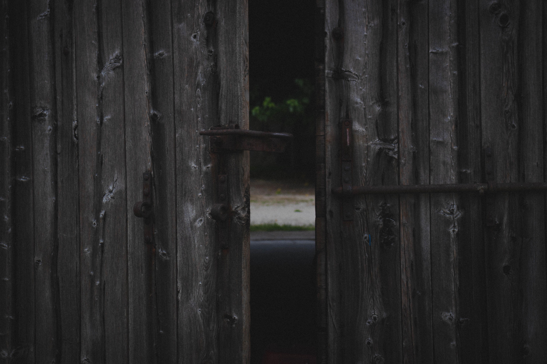 half opened brown wooden gate