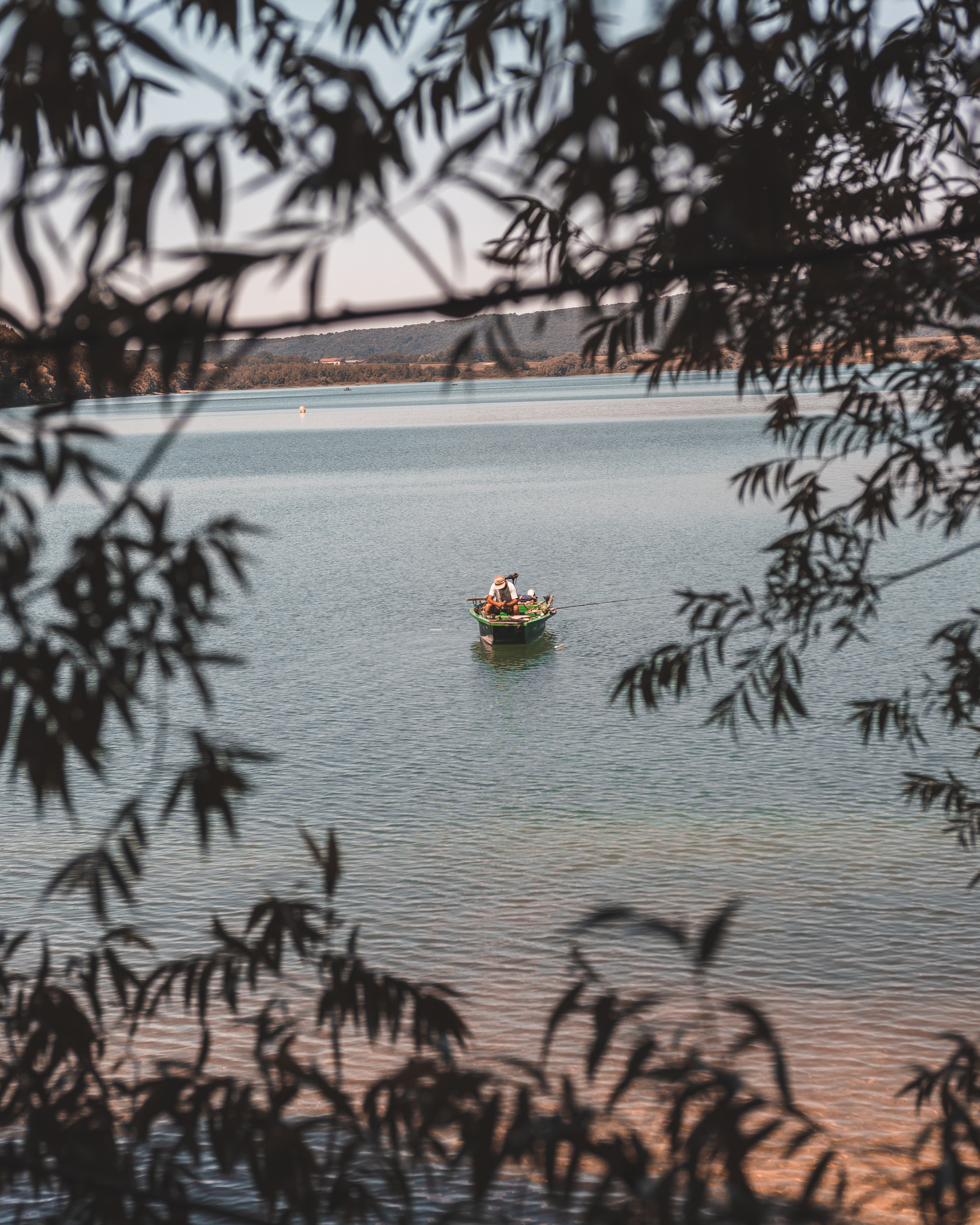 brown boat on body of water
