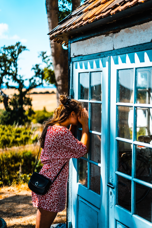 woman peeking on glass door