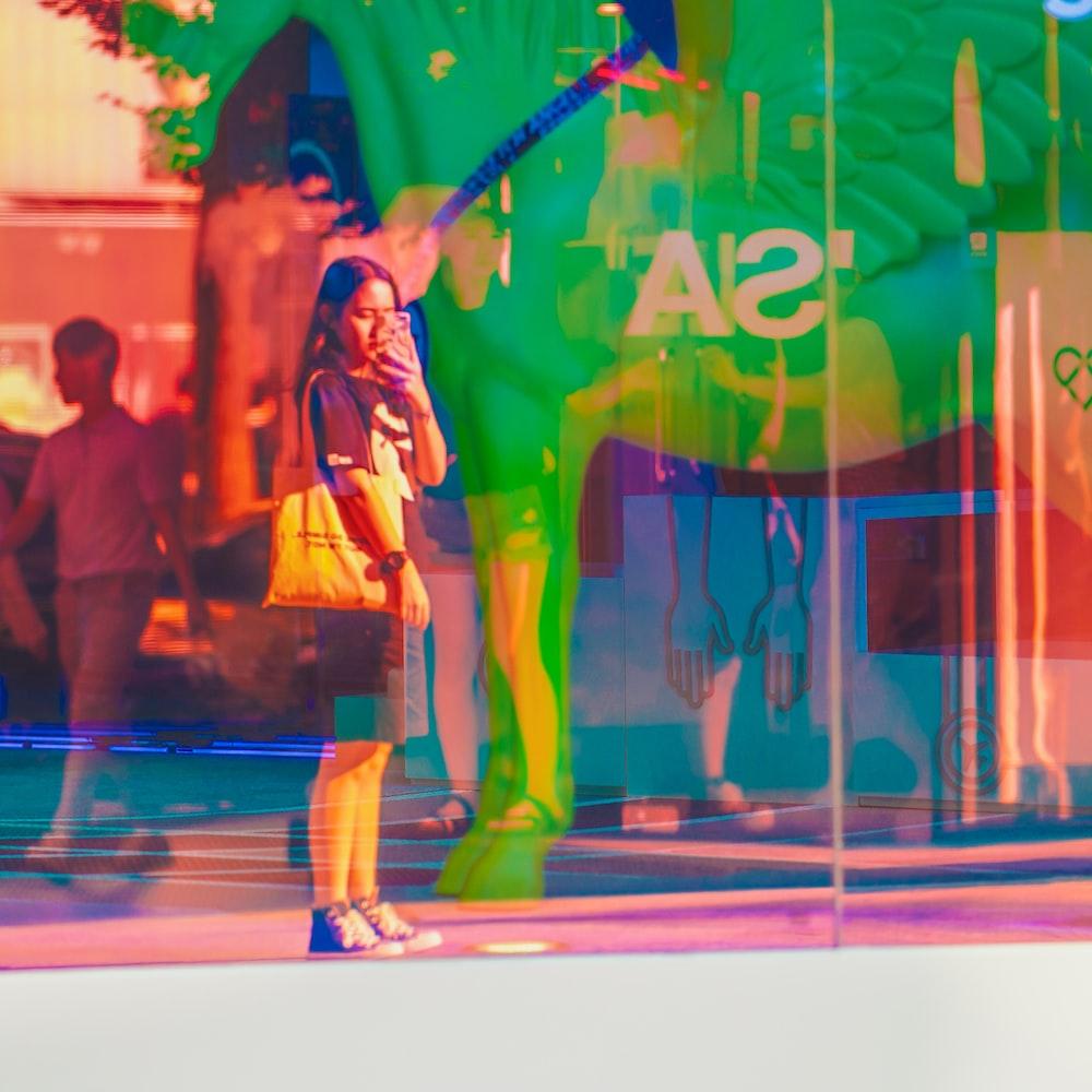 woman taking photo of street