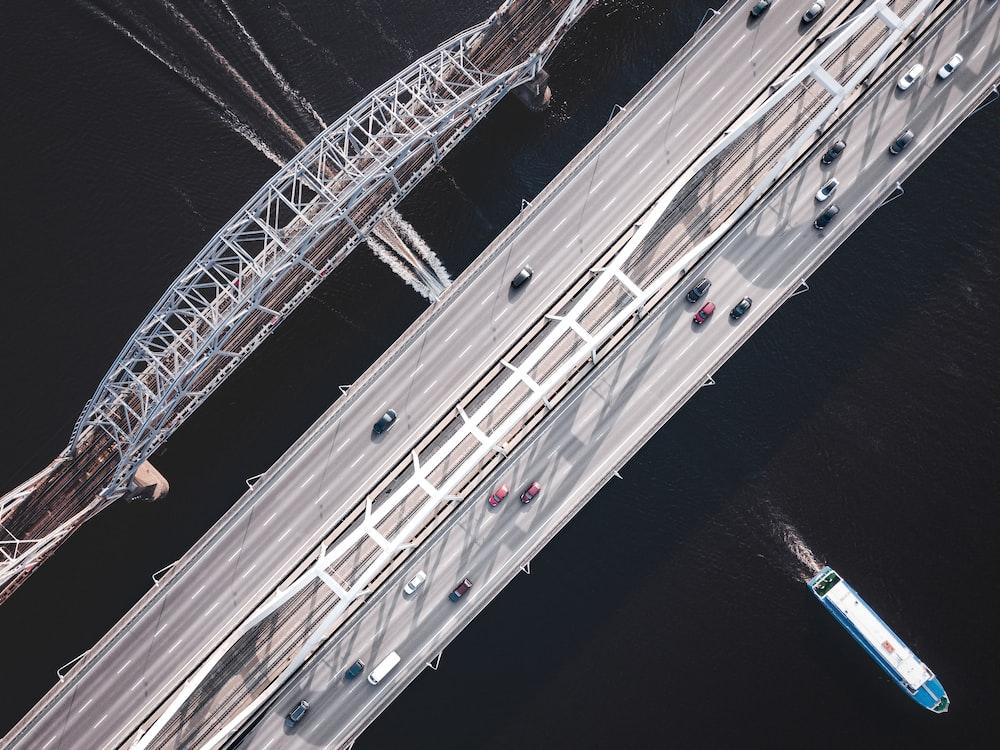 bird's-eye view of cars on gray bridge