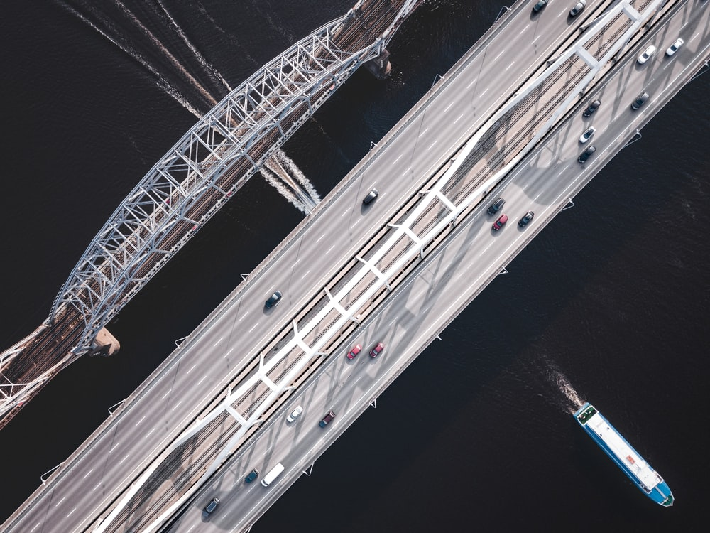 bird's-eye view of cars on gray bridge