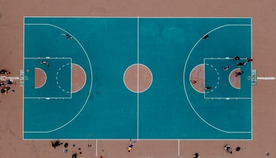 aerial photography of people playing basketball on court
