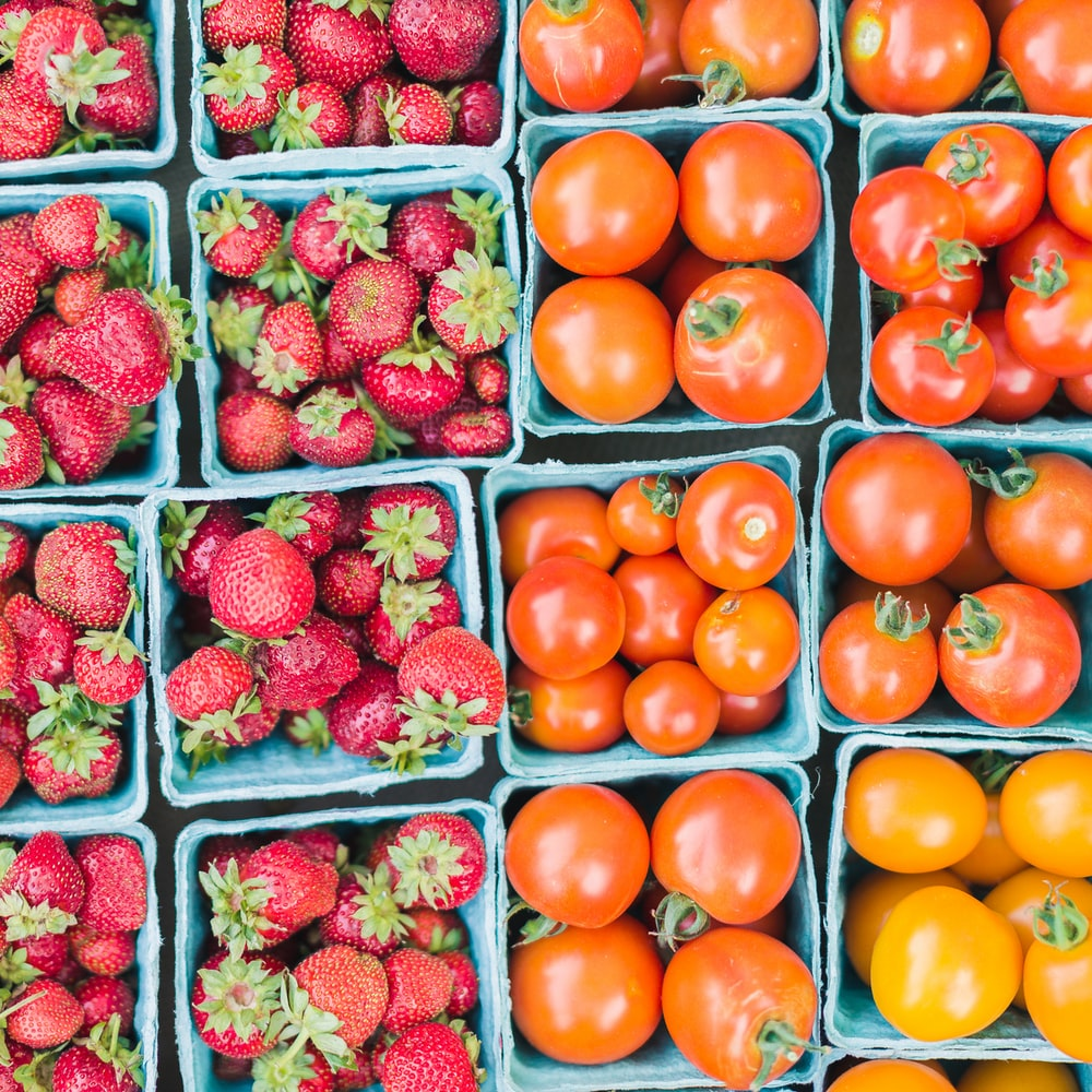 flat lay photography of strawberries and tomatoes