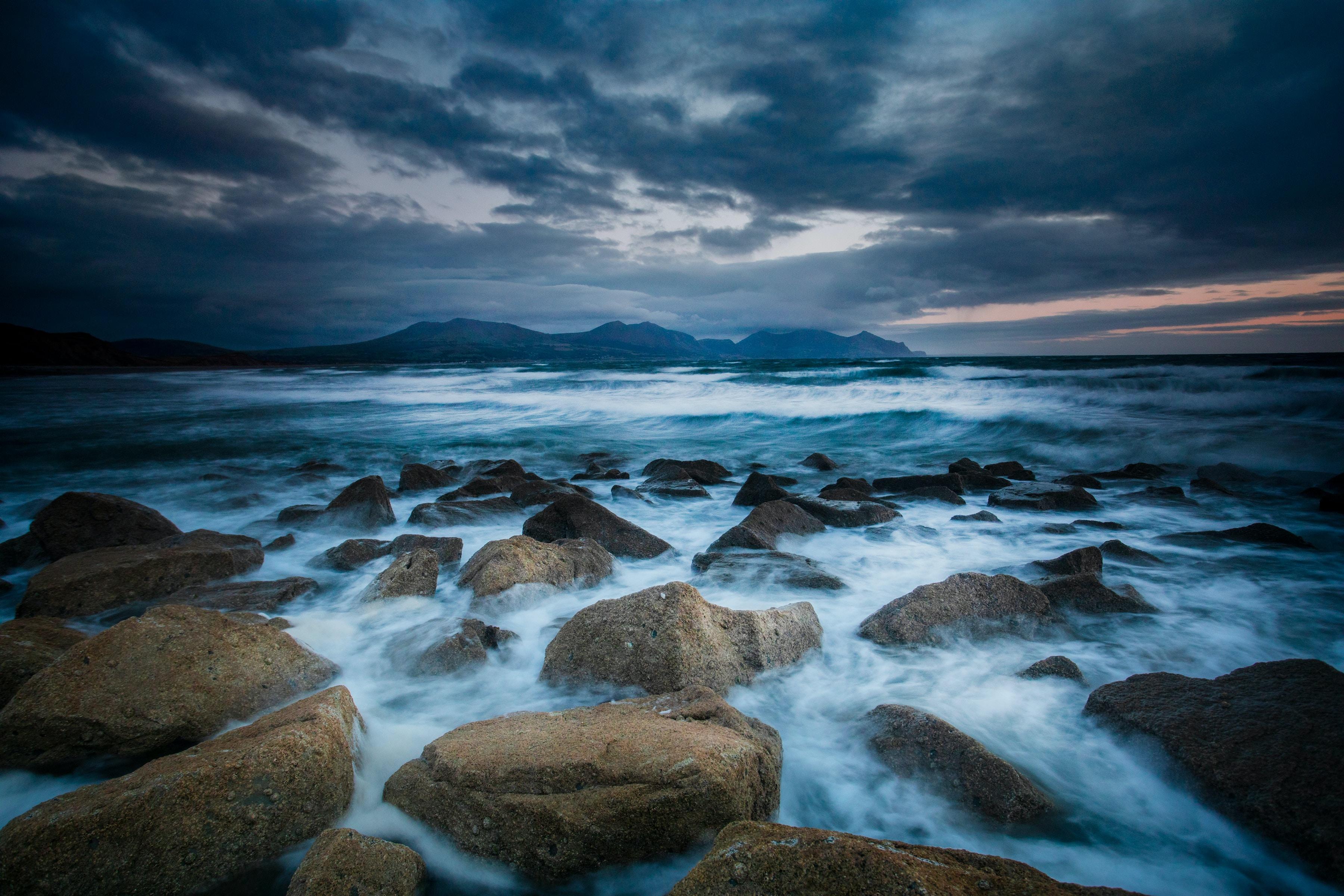 brown rocks on seashore during daytime