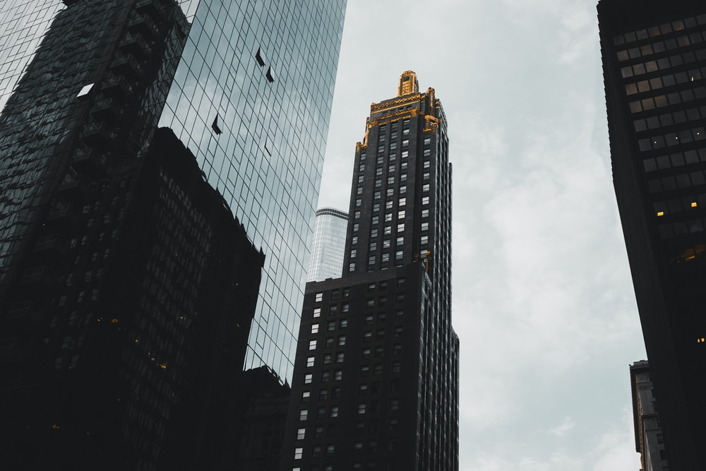 brown building under cloudy daytime