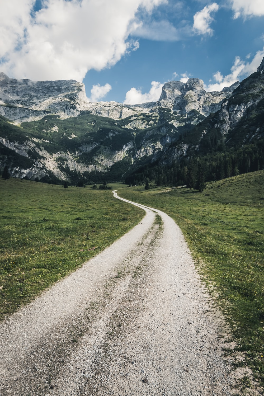 empty pathway near mountain