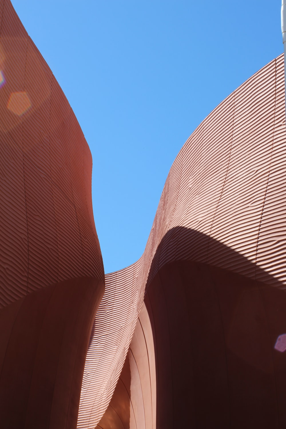 low-angle photo of brown architecture building