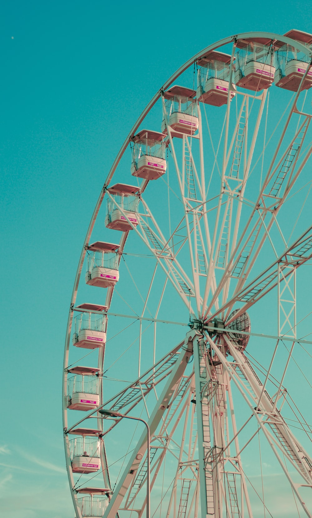photo of red and white Ferris wheel during daytime